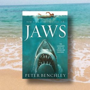 Image from Bookstagram Background image of the beach and Jaws book cover in the forefront