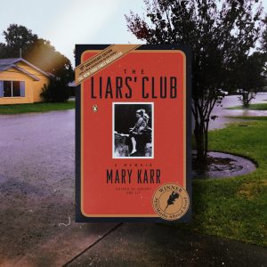 Bookstagram image. Background is a flood street in SETX and in the foreground is the book The Liar's Club by Mary Karr